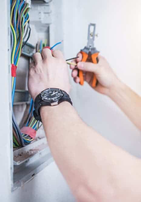 electrician with electric meter